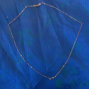 Jewelry - Simple gold chain w one blue gem